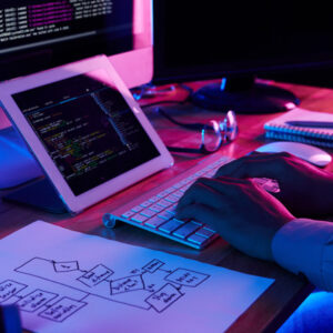 Close-up image of programmer working at his desk in office
